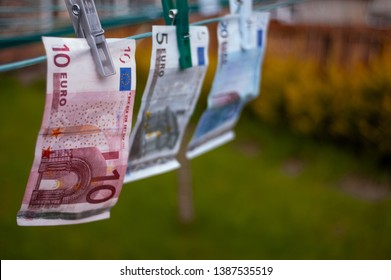 20, 10 and 5 euro banknotes pegged to a garden washing line