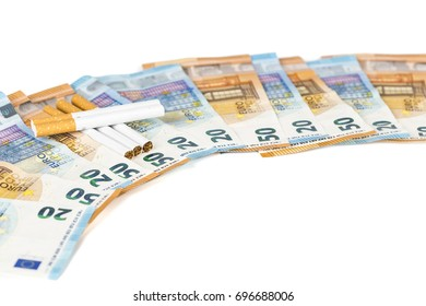 20 and 50 Euro banknotes bills cash with cigarettes, with cigarettes box. Concept of cost of tabacco, cigarettes. Front and top view, close-up. On white background