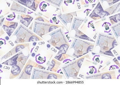 20 British pounds bills lies in big pile. Rich life conceptual background. Big amount of money