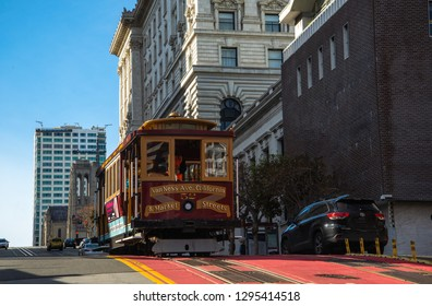 20 Dec 2018 - San Francisco, California, USA: Classic view of historic traditional Cable Cars riding on famous California Street, San Francisco