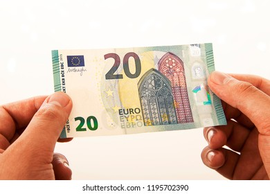 20 Euro banknote in hand on white background