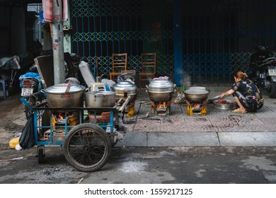 20 JULY 2019: asiatic woman prepare some street food on the road of saigon , vietnam.