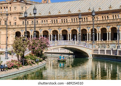 20 June 2017. Editorial. The group of tourists rides a boat on the Spanish square (Plaza de Espana) in Seville, Andalusia. Spain. One of the main touristic attraction in Seville