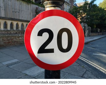 A 20 mile an hour red, white and black speed limit UK road sign