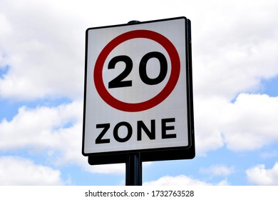 20 miles per hour driving speed limit sign with  a background of blue sky and clouds