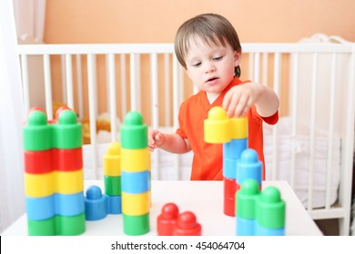 20 months baby playing constructor at home