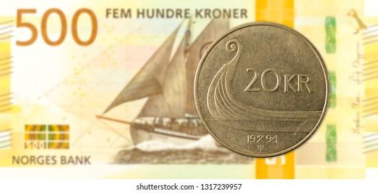 20 norwegian krone coin against 500 new norwegian krone banknote