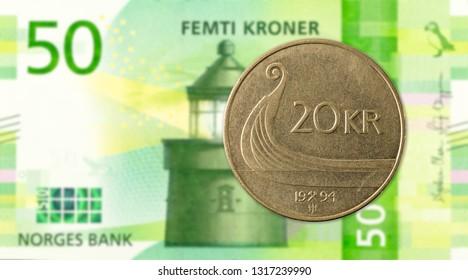 20 norwegian krone coin against 50 new norwegian krone banknote