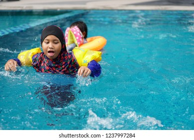 20 november 2018 , kuala lumpur  the holmes condominum baby and children bathing in the pool while learning to swim with use buoy