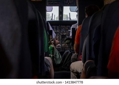 20 October 2018 , Pilot and co-pilot operating controls at cockpit . Route Lukla to Kathmandu , Nepal.
