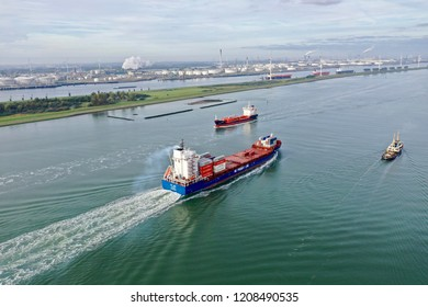 20 October 2018; Rotterdam the Netherlands; container ships entering the port of Rotterdam on a sunny autumn day with view of oil terminals in the background