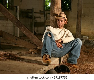20 Something Ranch Hand resting in old barn