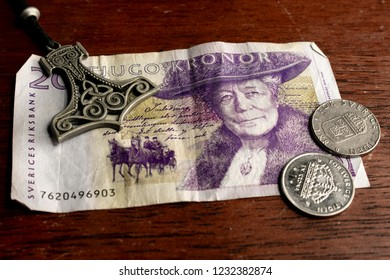 20 Swedish Kronor Bill with 1 Krona Coins and Mjolnir Pendant