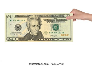 20 US dollar banknotes in hand isolated white background. Andrew Jackson replaced Grover Cleveland on the twenty-dollar bill in 1928