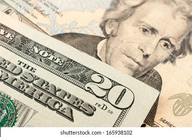 20 US Dollar on top of other
