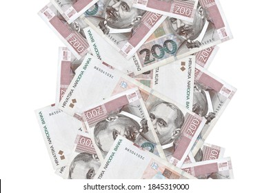 200 Croatian kuna bills flying down isolated on white. Many banknotes falling with white copyspace on left and right side