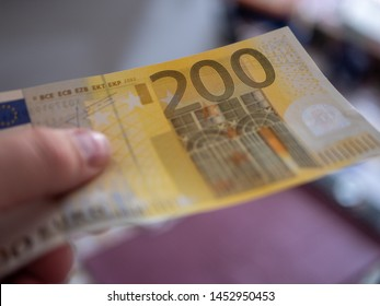 200 Euro in the male hand background