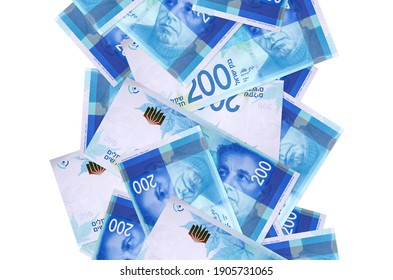 200 Israeli new shekels bills flying down isolated on white. Many banknotes falling with white copyspace on left and right side
