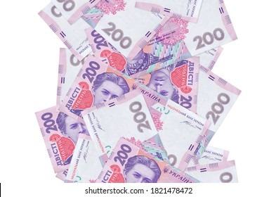 200 Ukrainian hryvnias bills flying down isolated on white. Many banknotes falling with white copyspace on left and right side
