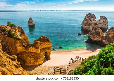 200 wooden stairs leading to Praia do Camilo, Algarve, Portugal