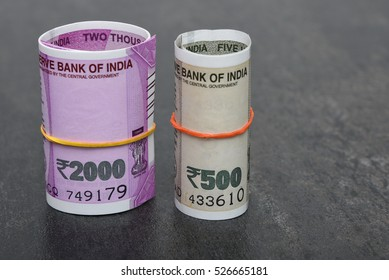 2000 and 500 rupee banknote India,The brand new Indian currency notes of 2000 and 500 rupees isolated on black. These have been introduced to curb black money. Success and got profit from business