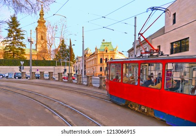 20.04.2018. colorful facade of old architecture bildings, cathedral tower and old red tram on the street of Belgrade, Serbia