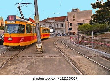 20.04.2018. colorful facade of old architecture bildings  and old red yellow tram on the street of Belgrade, Serbia