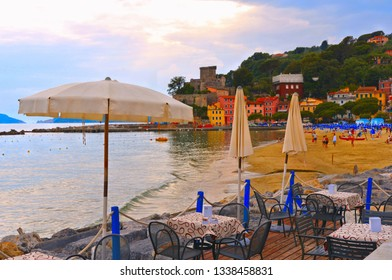 20.04.2018. outdoor tables and chairs of near restaurant on the beach in San Terenzo Lerici, Liguria, Italy
