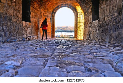 20.04.2018. A tourist walk under one of old gates in Kalemegdan fortress and castle with Sava river and landscape in background. Belgrade Serbia