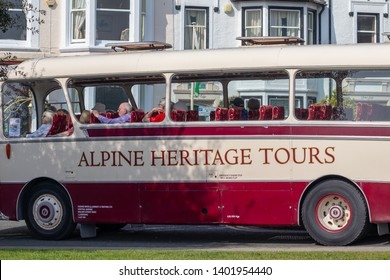 20/04/2019 Llandudno , UK . Bus and coach company in Llandudno ,Wales. Alpine Travel's Great Orme Tour uses vintage coaches to transport guests around the famous Great Orme in Llandudno.