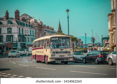 20/04/2019 Llandudno Wales UK. Beautiful Llandudno and vintage bus.Alpine Travel's Great Orme Tour uses vintage coaches to transport guests around the famous Great Orme in Llandudno.