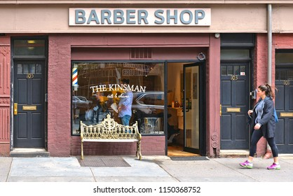20.05.2016. NEW YORK CITY,  Greenwich Village View of Barber shop windows with golden bench and young girl walking on a street in Manhattan.