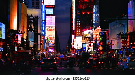 20.05.2016.  New York USA, urban night scene, colors and neon commercial advertising lights, people and big traffic with colorful cars in Time Square  in Manhattan