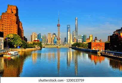 20.05.2017.historical Waibaidu bridge with water reflections and colorful blue sky in front of the futuristic modern skyline of Pudong Shanghai, China