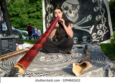 20.05.2018 Kyiv, Ukraine. Young musician playing didgeridoo on the traditional street music festival in Kiev