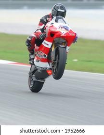 2006 MotoGP Sepang F1 International Circuit Malaysia - a rider doing wheelie in action