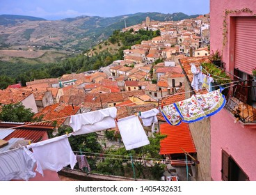 20.08.2017. Landscape with colorful roofs of Pietrapertosa village in Apennines Dolomiti Lucane with mountains in background. Basilicata, South Italy