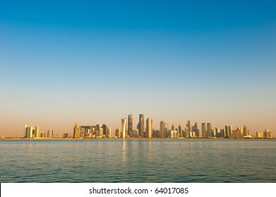 2010 Skyline of the arabian city of Doha in Qatar, captured in the very early morning with the rich warm colours from the sun reflecting off the glass skyscrapers.