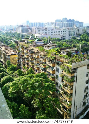 2010.8.14, in city of Nanning, China, aerial view of some residential apartment buildings with balcony gardens and rooftop gardens.