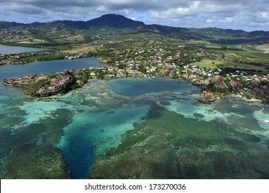 2011. Mar. The aerial view of Martinique, near Le Francois,  with while sand beach and turquoise blue water and volcanic mountain, Caribbean Sea