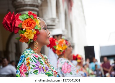 Mérida, Yucatán/México-October 2011:  Young women dressed in traditional yucatan garment waiting their turn to perform a dance in city festival.