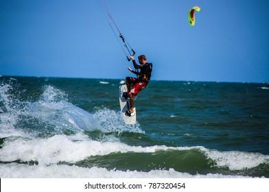 2012 Feb 26 A man Play Kitesurfing at Hua Hin District Thailand