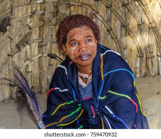 2014, Aug 25, Kwazulu Natal, Africa: Sangoma, a traditional Zulu healer, in ancestral clothing inside a beehive hut. She is a spirit medium for the Zulu people; the cow-tail whisk signifies dignity.