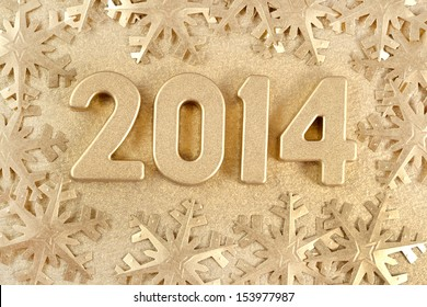 2014 year golden figures on the background of golden snowflakes