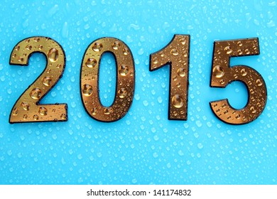 2015 in golden numbers, on blue background