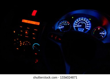 The 2015 Honda City car dashboard in the night light with beautifully colorful alphabets and indicators. Bangkok, Thailand November 1, 2015