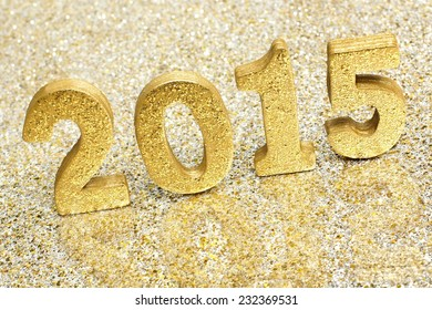 2015 New Years Eve golden numbers on a glittery background