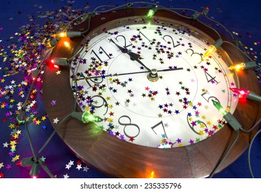 2015 New Years Party Background. Clock, festive tinsels and light