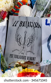 2015, November - Paris, France : Flowers, messages, photos and french flags in honor of victims of terrorist attacks of November 13th in Paris at the Bataclan.