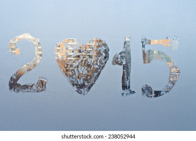 """2015"" written on frosty winter window."